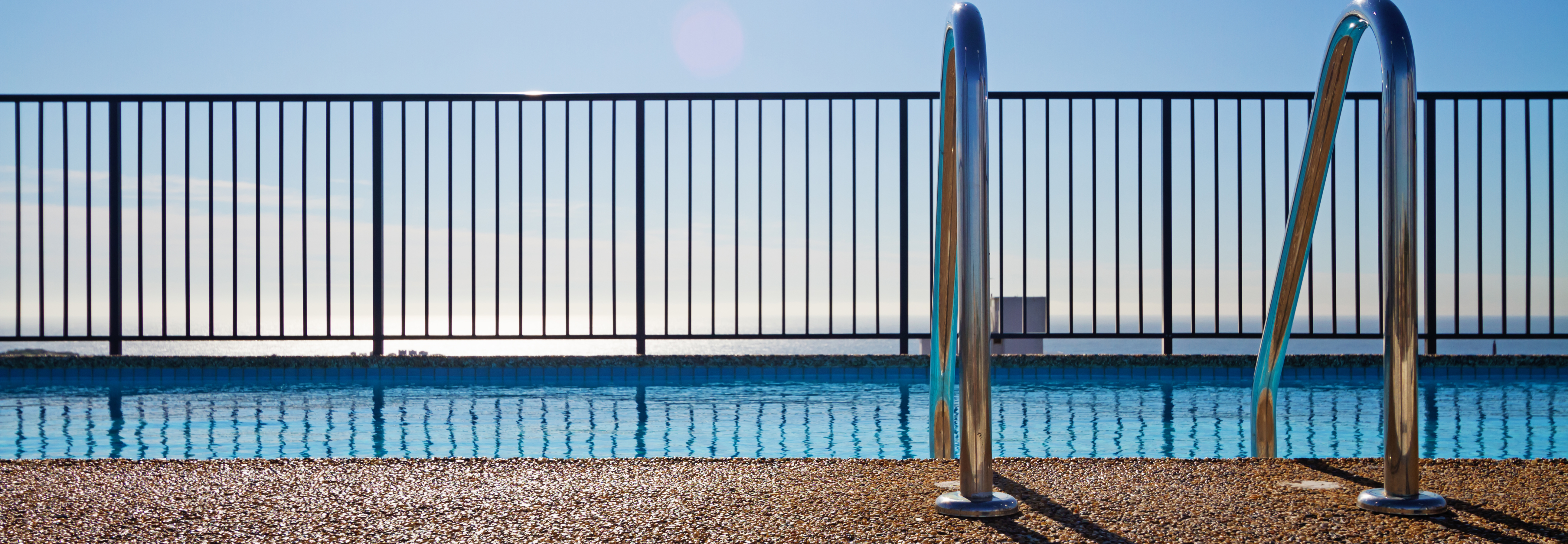 istock-swimming pool with fence